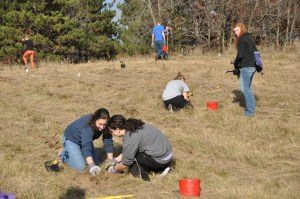 Students planting oak trees for the Fish Creek project